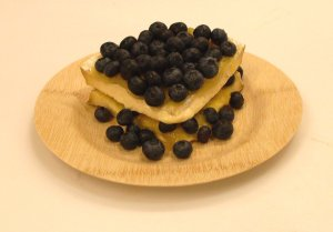Brie de Nangis with fresh blueberries and lemon curd